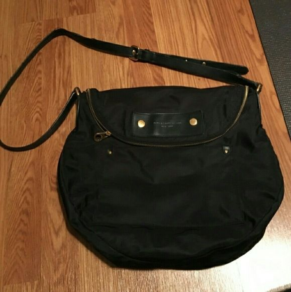 Authentic Marc Jacobs black cross body Authentic Marc Jacobs cross body. Only minor wear, as seen in photos.  Super soft material. Very fashionable. Smoke and pet free home. Discount bundles and open to reasonable offers only Marc by Marc Jacobs Bags Crossbody Bags