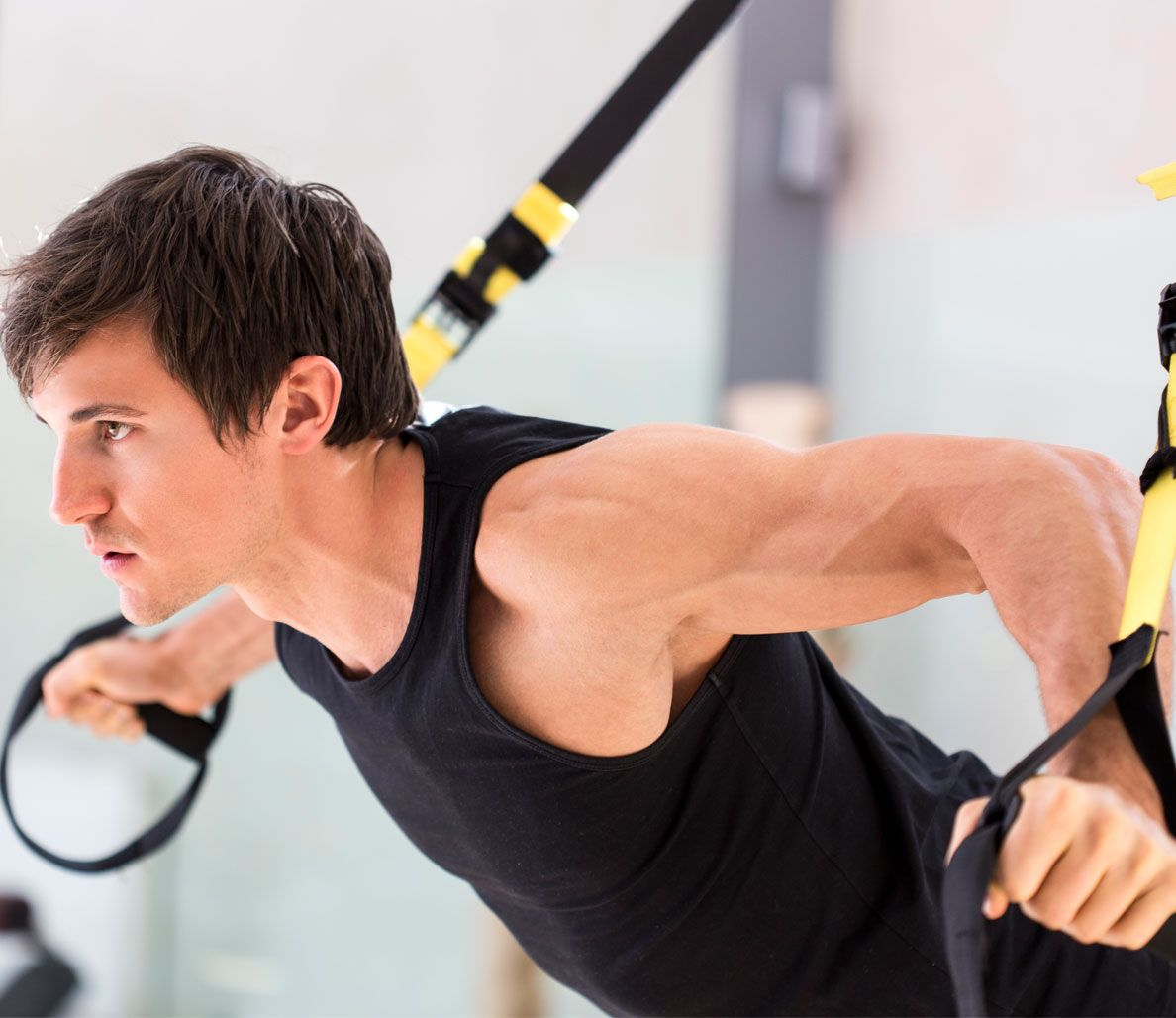 Sick of weightlifting the old-school way? Try these suspension training moves that'll kick your ass and give you the muscle-building workout you crave.