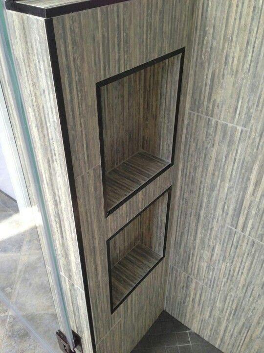 Custom niches with oil rubbed bronze schluter trim around