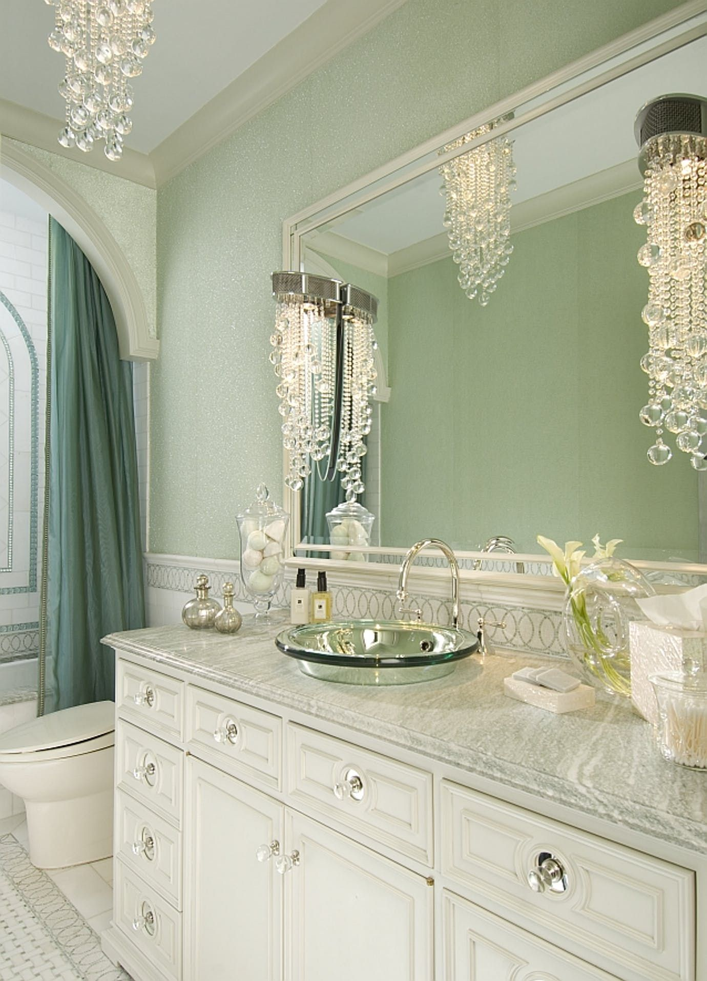 The bathroom shimmers with glass beaded wallpaper, hung above a ...