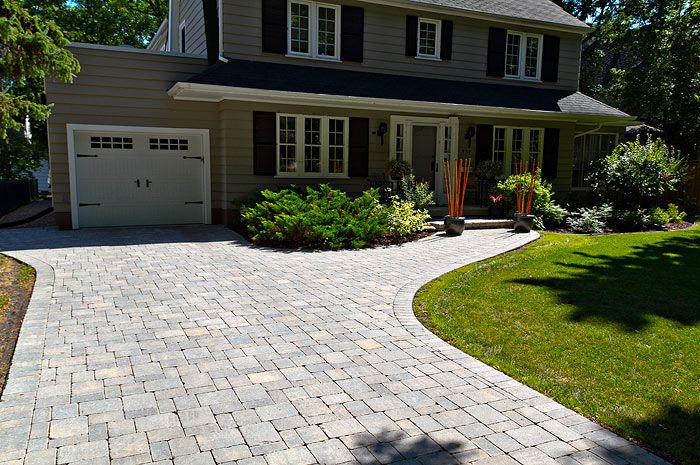 Photo of A driveway is the gateway to the home. Of course she has to …