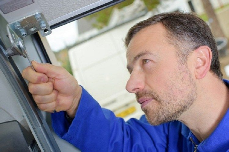 History Of Garage Doors And How To Repair Them Garage Door Maintenance Door Repair Garage Door Repair Service