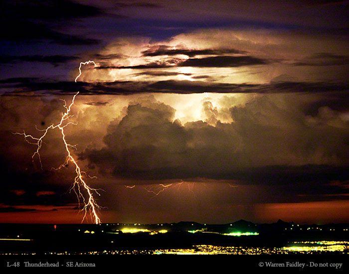 Bright lightning illuminates dark cloudy sky during a ...   Tiger Coming Out Tornado Lightning