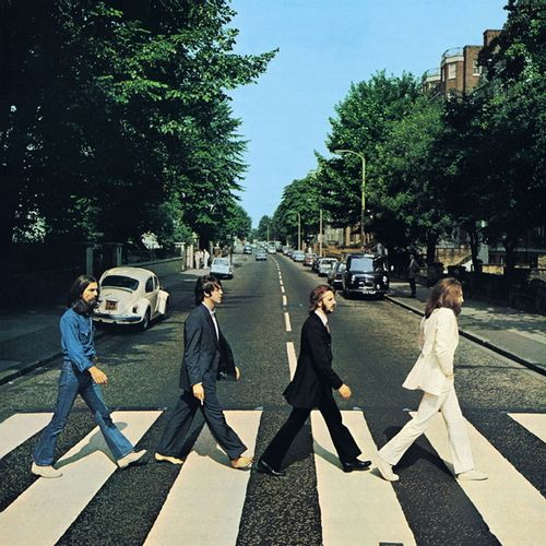 """The Beatles - """"Abbey Road"""" (1969). Cover photograph taken 8 August 1969 outside EMI Studios on Abbey Road. At around 11:30 that morning, photographer Iain Macmillan was given only ten minutes to take the photo whilst he stood on a step-ladder and a policeman held up the traffic."""