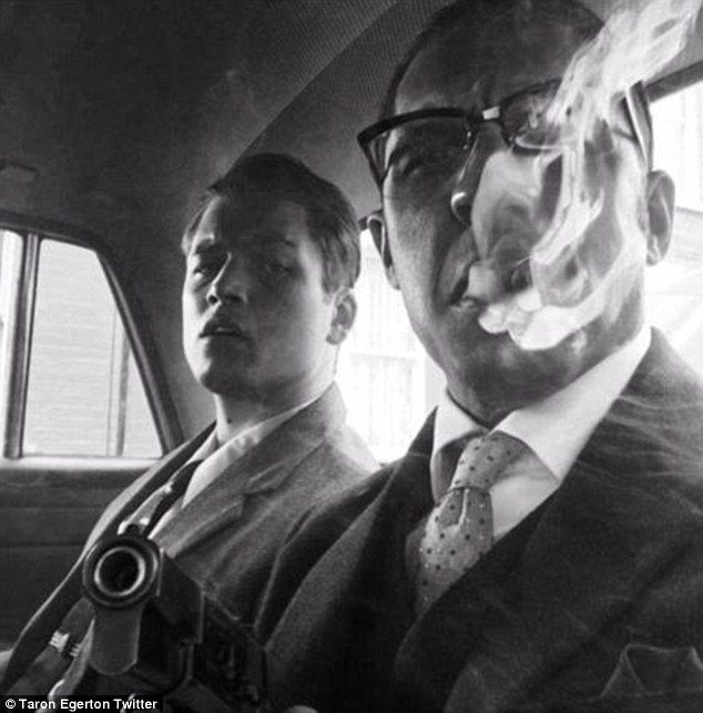 Hard men: Taron Egerton posts a black and white picture of himself in character with Tom Hardy on the set of The Krays film Legend