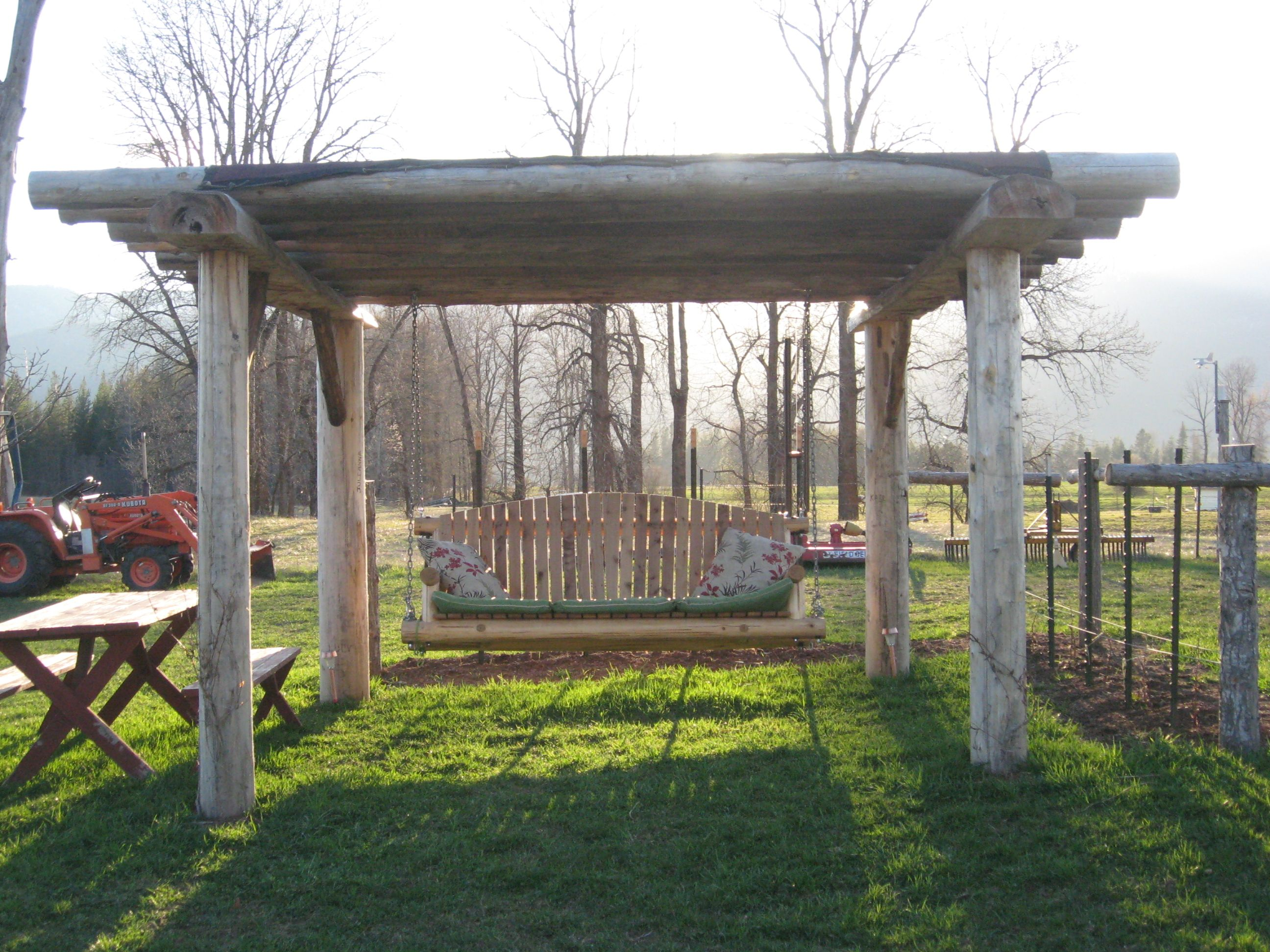 cedar log pergola swing woodn t it be nice pinterest