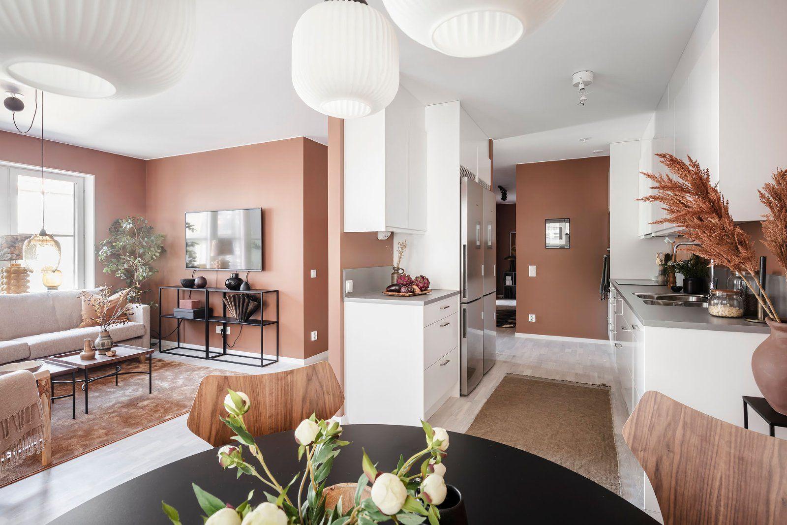Cuisine semi-ouverte dans un appartement aux tons chauds - PLANETE DECO a homes world en 2020 ...