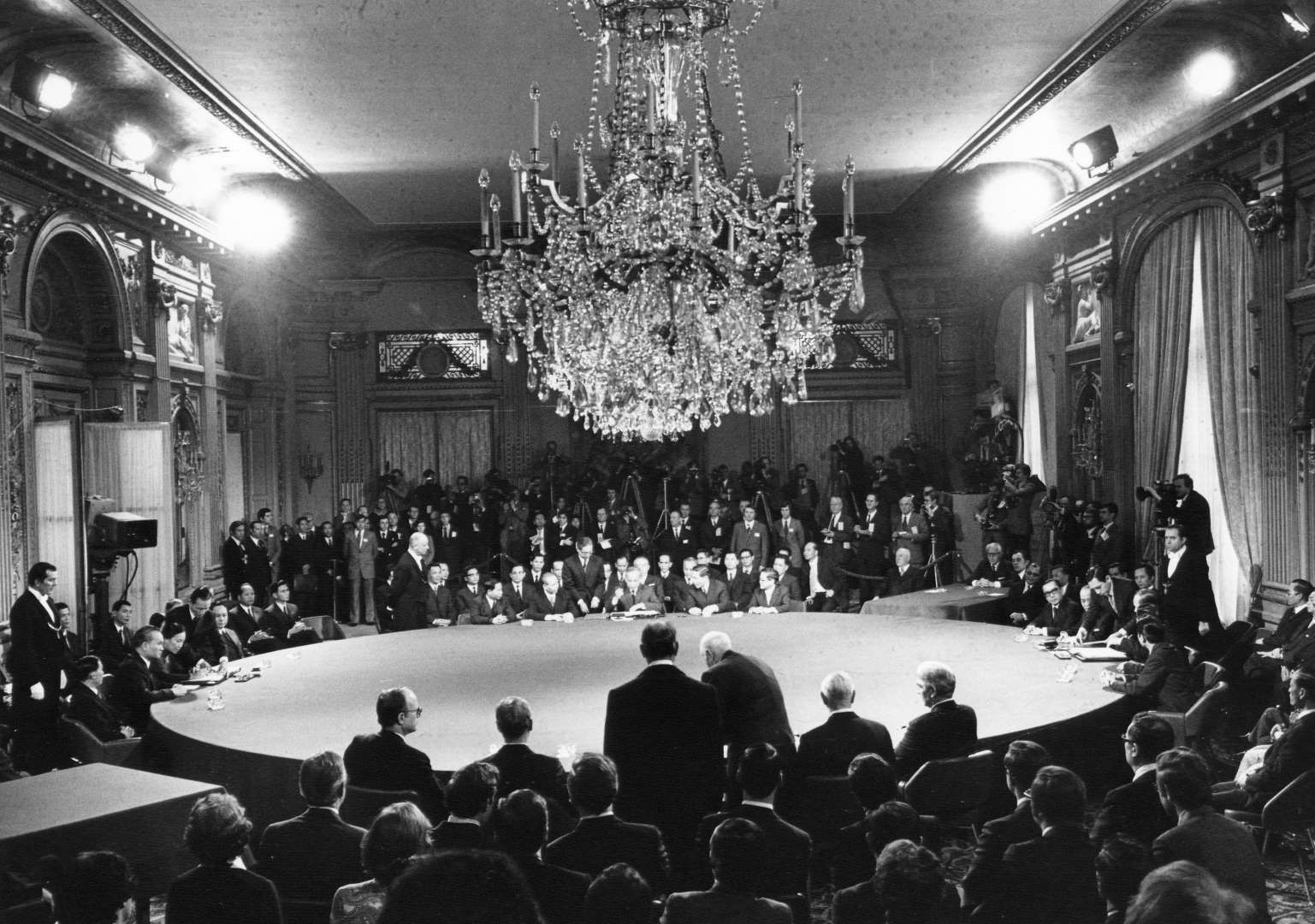 The Four Delegations Sit At The Table During The First Signing