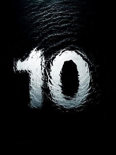 White 10 Ten Submerged In Water On Black Background Graphic