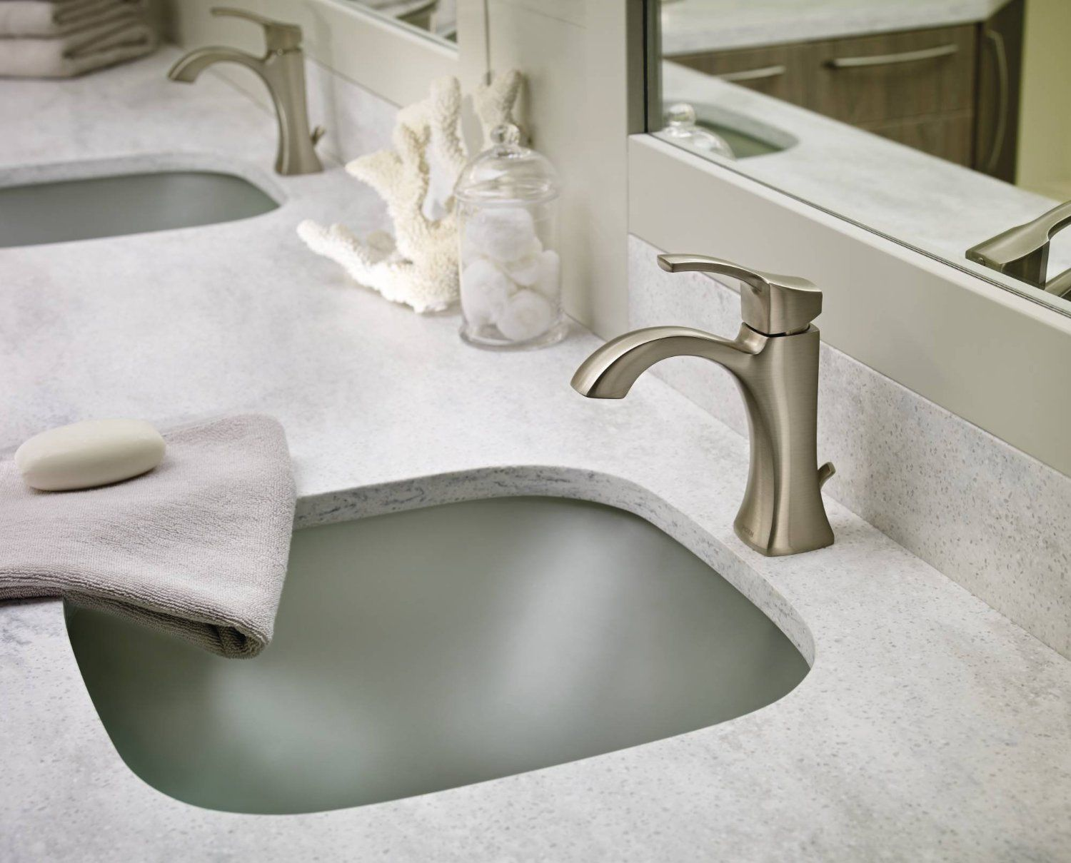 This Voss high arc bathroom faucet features crisp edges and a ...