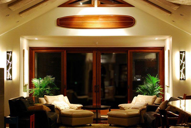 living room with wood surfboard wall decor; nautical room decor ...