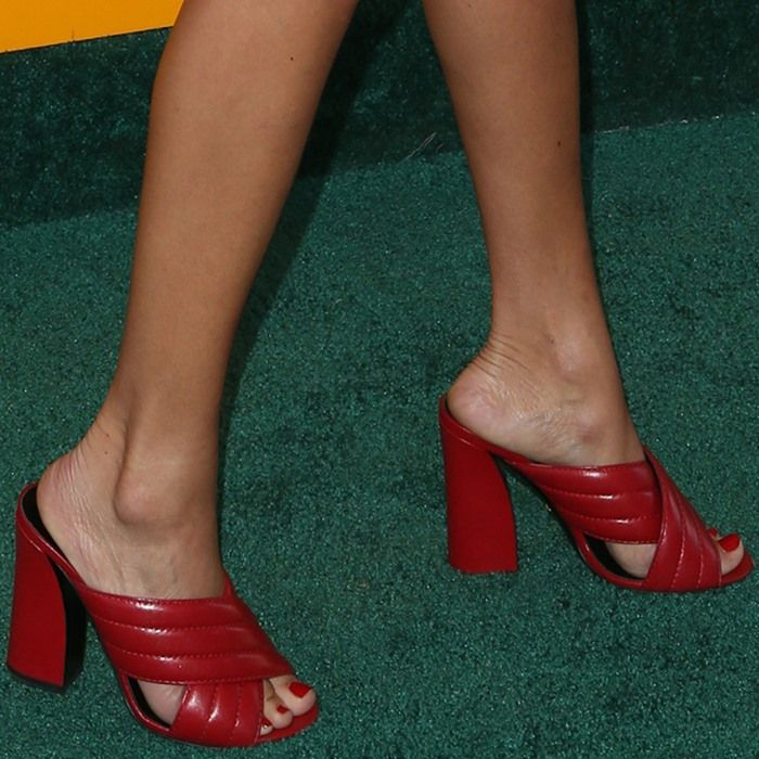 The London-born actress Ashley Madekwe wearing red Gucci leather sandals