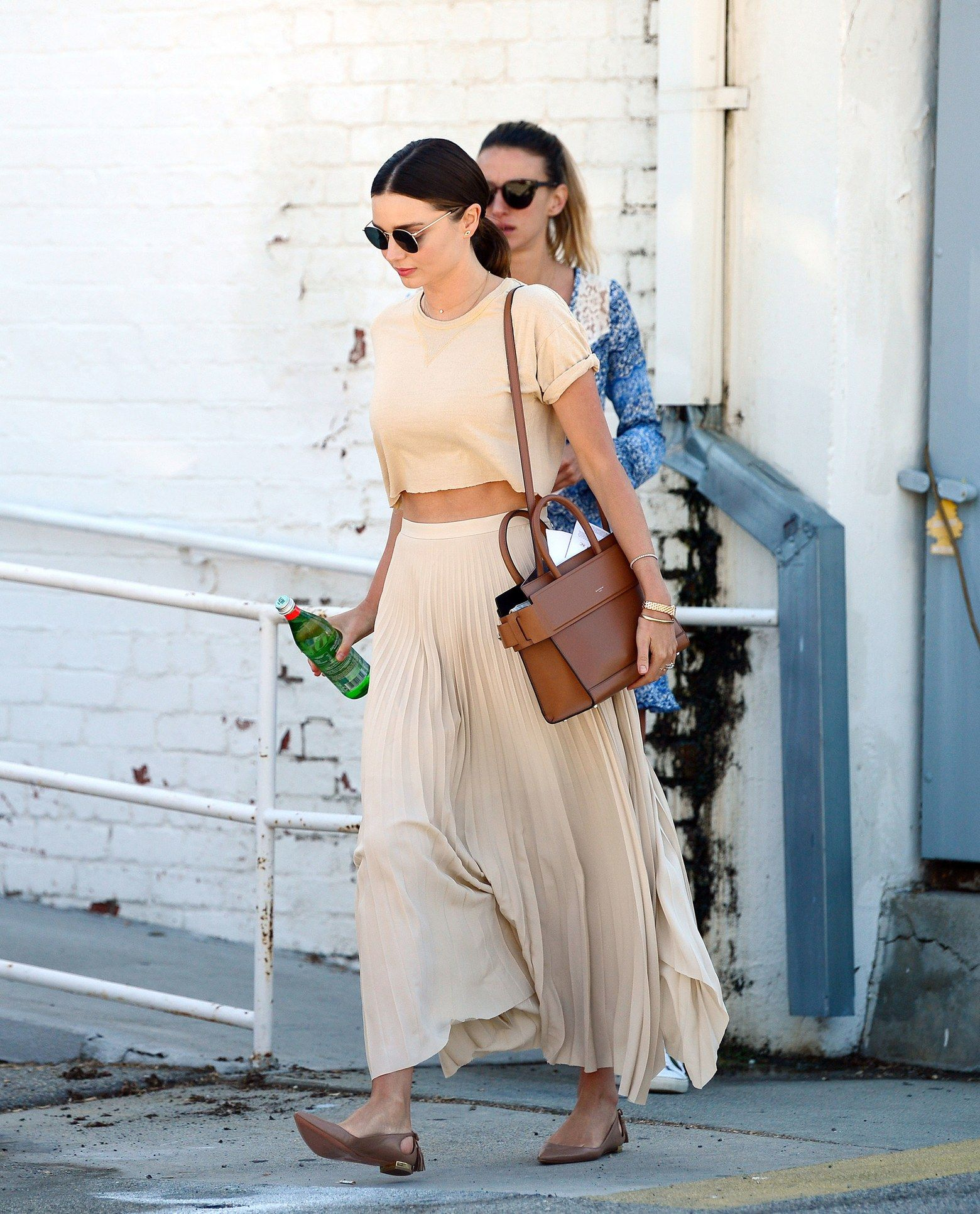 e4a7b7d8e2785 Miranda Kerr Style Nude crop top with pleated skirt summer outfits ...