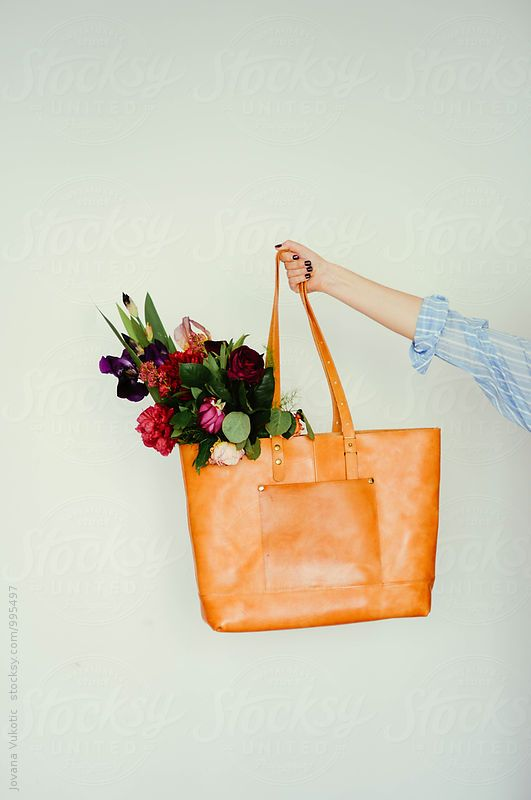 A Woman Holds A Flower Bouquet Leather Bag Bags Leather