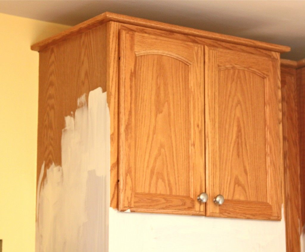 Painted kitchen cabinets with chalk paint by annie sloan for Painting wood cabinets white before and after