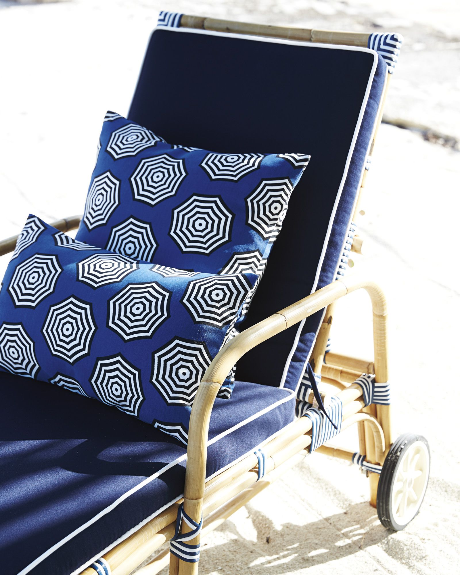 Love the rattan chaise add a blue cushion with white piping for a