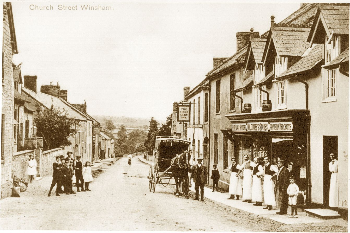 Photo of winsham village shop front in late 1800s, horse and carriage in the road