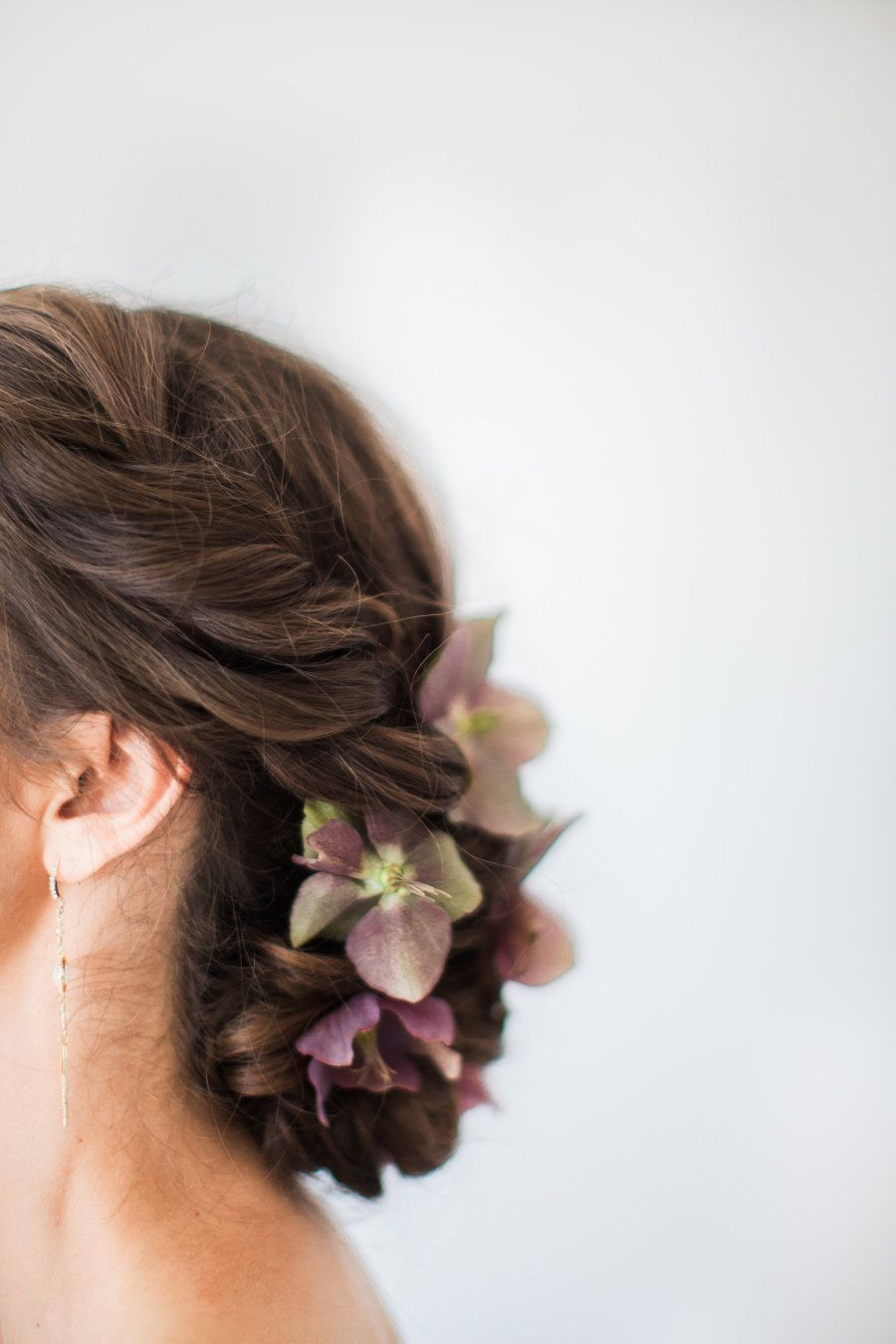 Flower infused wedding hairstyle photography natalie bray