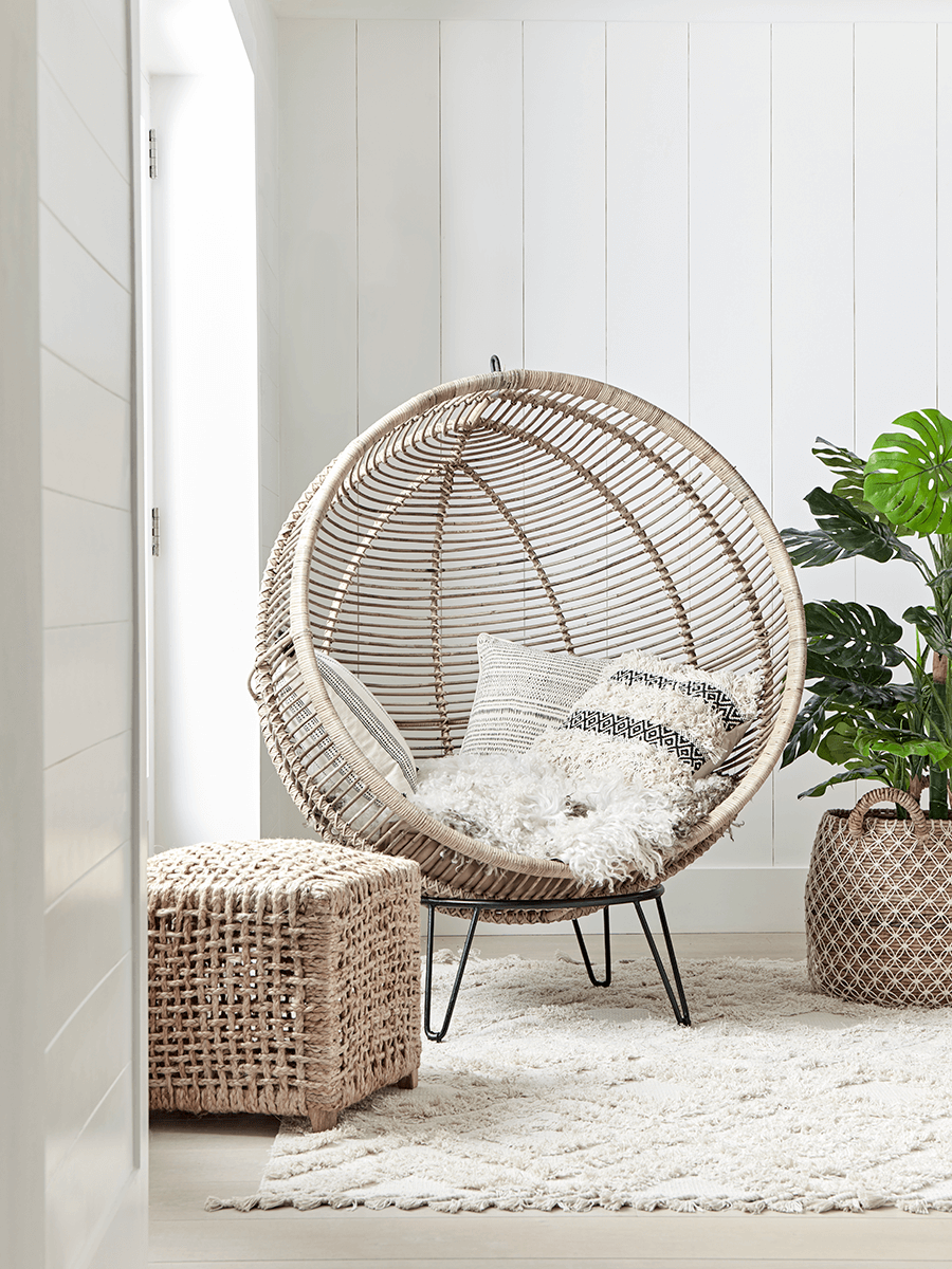 Made from blonde rattan with a beautiful open weave and elegant round shape our statement cocoon chair is the perfect accent piece for any living space