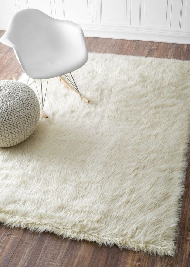 A fuzzy rug that cushions your feet if you ever dare step out of bed ...