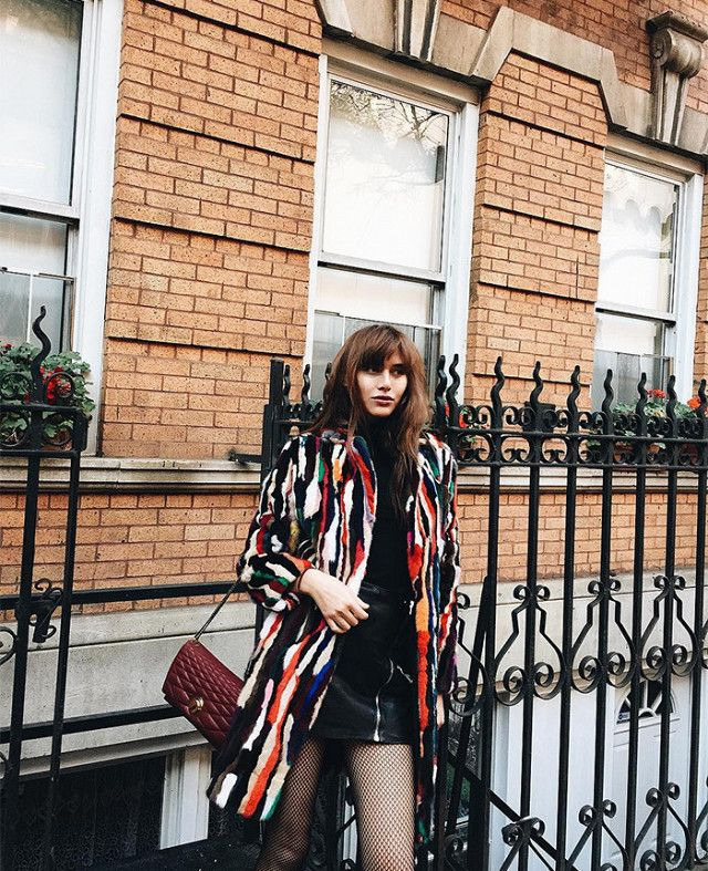 Love the colorful stripes on this faux fur coat.