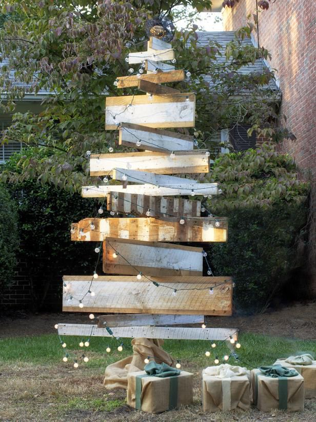 Build a Rustic Tree Give your front yard a one-of-a-kind look with a handmade wooden tree made from reclaimed barn wood, LED bistro lights and galvanized wire bundled together to make a vintage-inspired tree topper. Watch the video how-to. You Might Also Like... How to Make a Wooden Christmas Tree