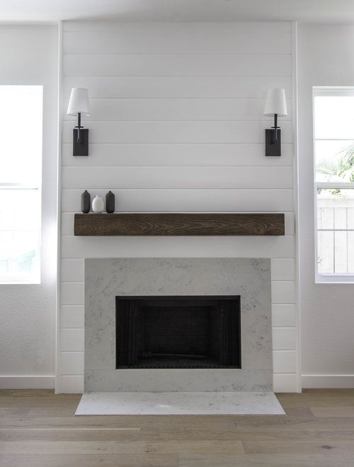 I'm not a fan of the sconces, but I love everything else about this fireplace.
