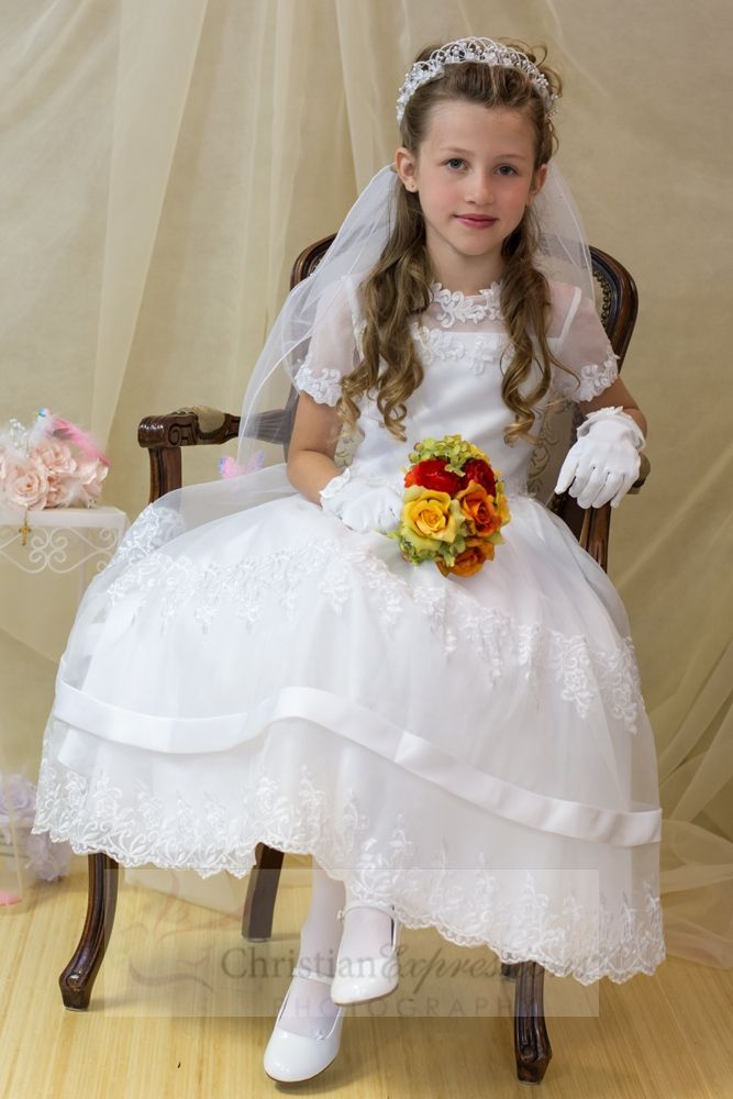 3b377f2f6fb Satin first holy communion dress with organza overlay accented with lace  throughout and satin banding.