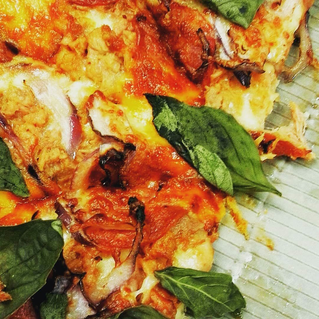 Delicious Takeaway Tuna Pizza With Red Onion Rings And Fresh Basil