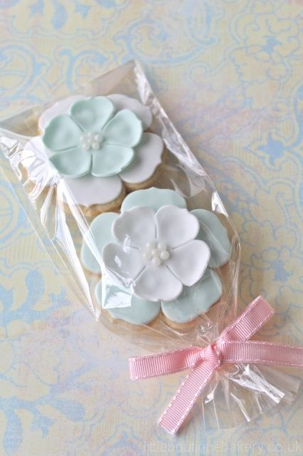 white mint wedding favours cookies in pretty shapes in plastic wrap with bows