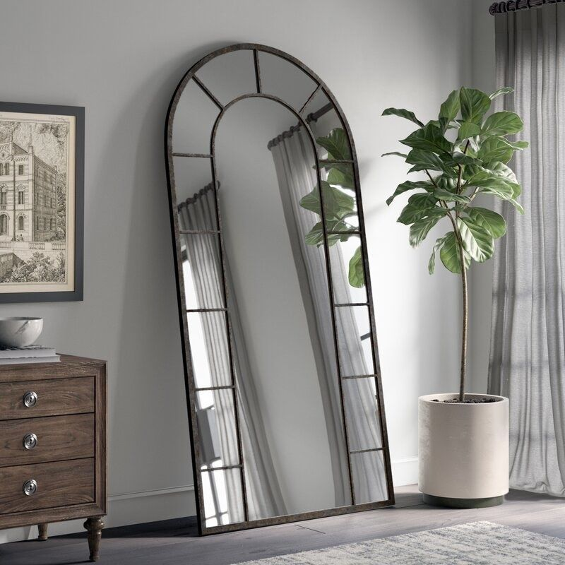 Photo of An arched mirror for reflecting light into small spaces and making them look larger. Also, we can all agree that it's just really freaking pretty, OK?