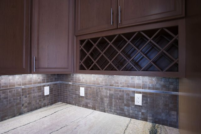 San Mateo, CA: Under-cabinet lighting and wine storage. Valley Home Builders