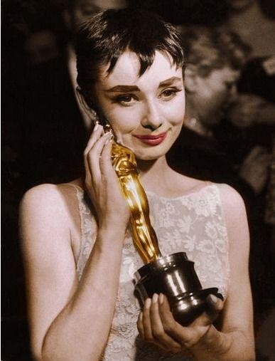 Audrey Hepburn and her Oscar (1954).