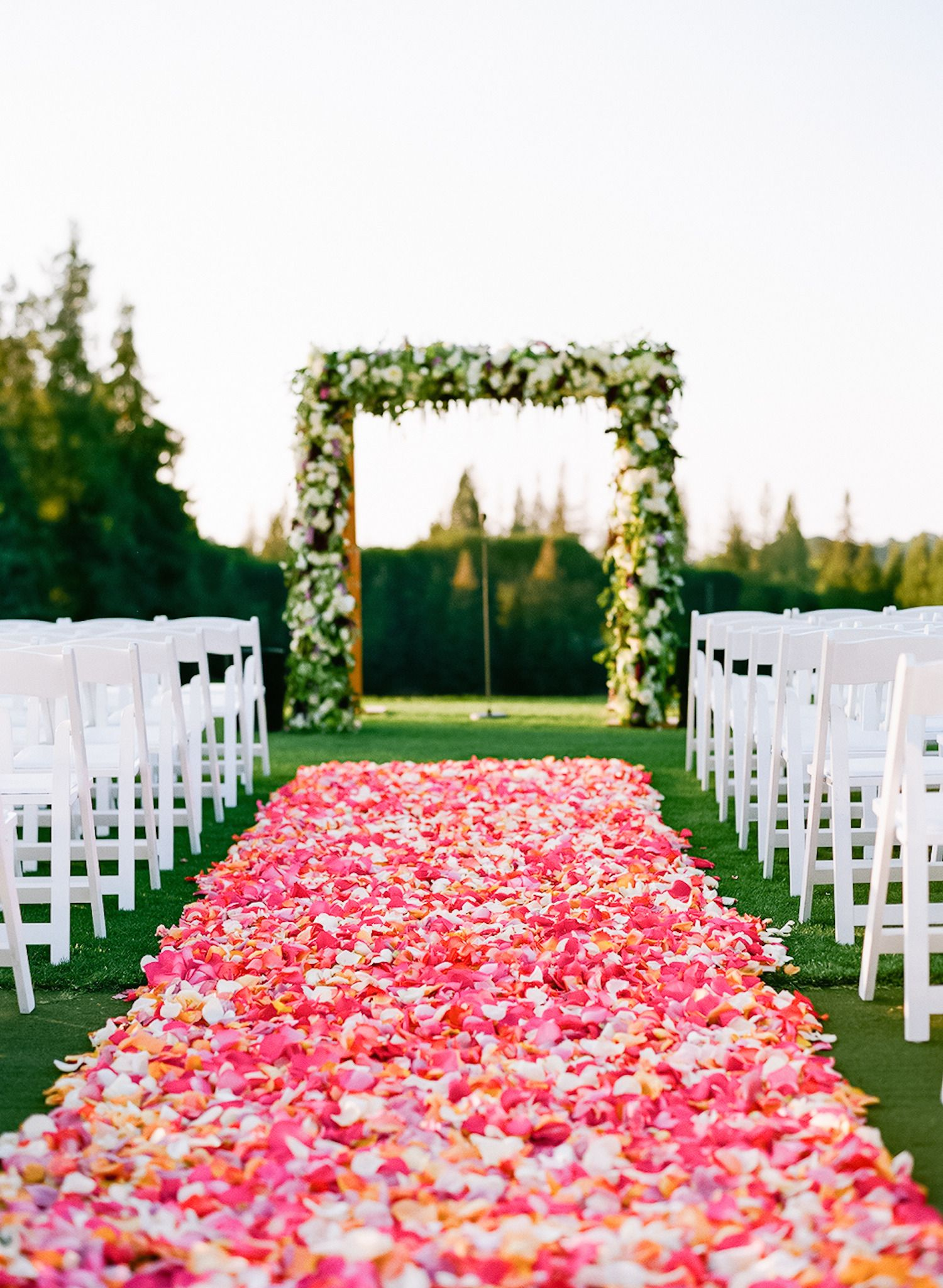 Pink + red petals down the aisle. #decor #ceremony Photography: Stephanie Pool - stephaniepool.com Read More: http://www.stylemepretty.com/2014/08/28/colorful-spring-palo-alto-wedding/