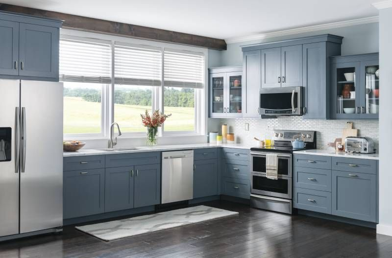 Country Blue cabinets mixed with sleek stainless steel ...
