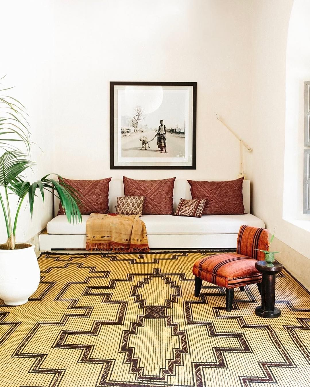 ethnic boho living room with low sofa and patterned rug love the rh pinterest com