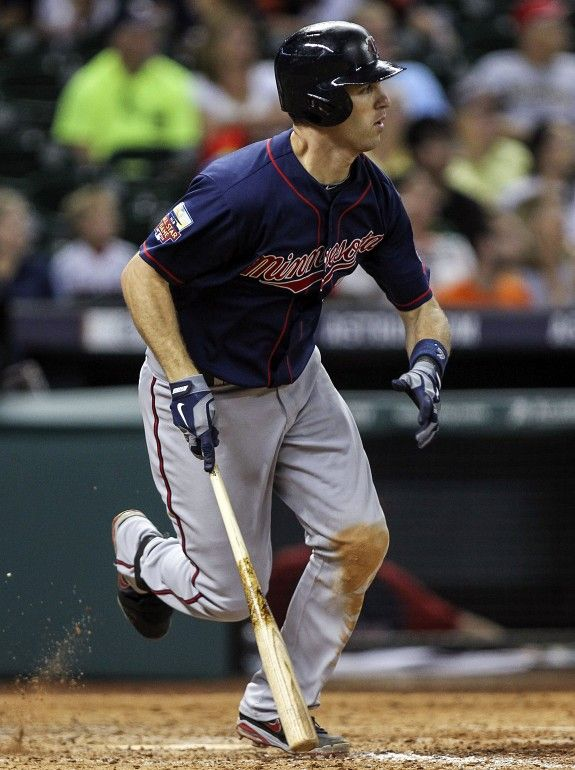 Aug 11, 2014; Houston, TX, USA; Minnesota Twins first baseman Joe Mauer (7) drives in two runs with a single during the ninth inning against the Houston Astros at Minute Maid Park. Mandatory Credit: Troy Taormina-USA TODAY Sports