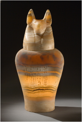 Egyptian Canopic Jar Ca 400-200 BC. Containers like thes held the deceased's lungs, stomach, liver, and intestines. The jackal, Daumetef, is guardian of the stomach.