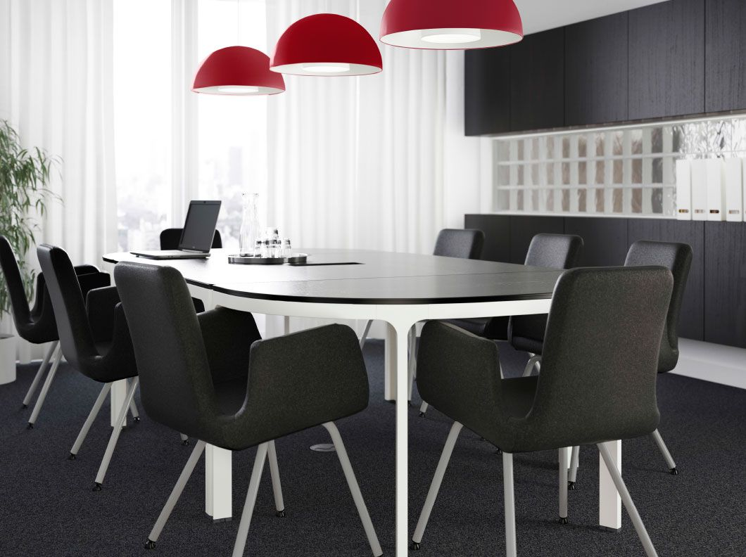 A Large Conference Room With A Big Table In Blackbrown With White - Black conference room table
