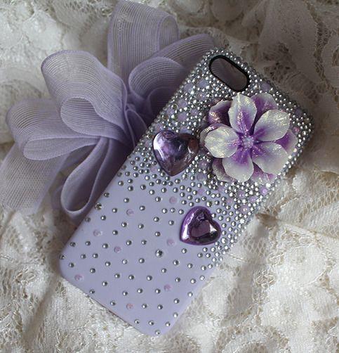 Handmade phone cover featuring a very beautiful glittery geranium cabochon.