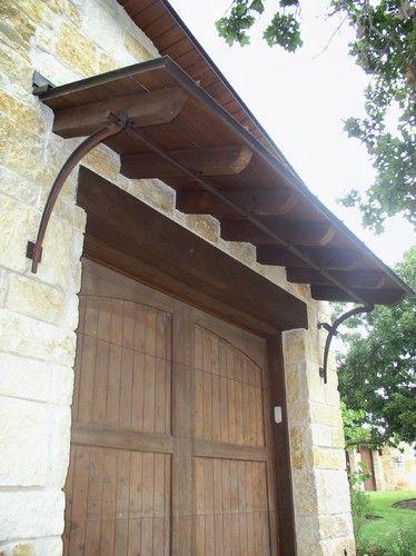 Garage Door Shed Roof And Iron Bracket Support Mediterranean Exterior Mediterranean Decor Mediterranean Homes Metal Awning