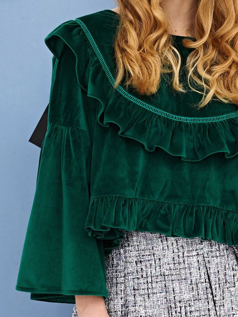 a115b164ae9 A super luxe forest green velvet volante top with ruffles on bib and hem.  Keep it casual with a pair jeans or dress it up with a mini skirtFabric ...