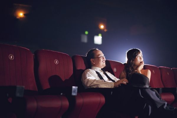 movie house, couple, candid