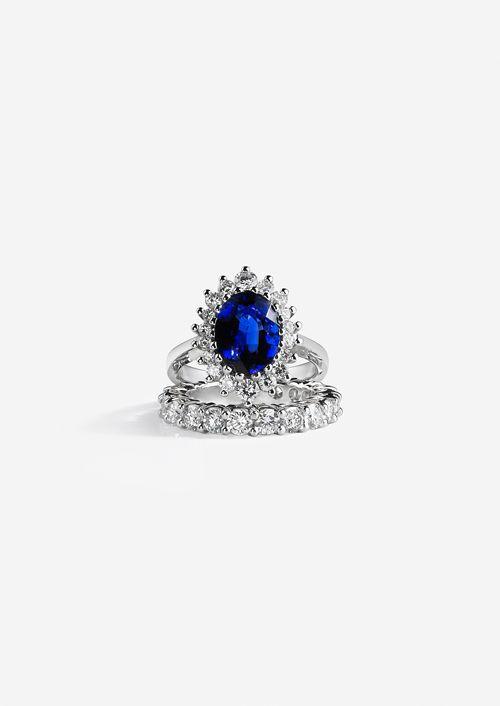 "Bespoke platinum bridal set: fabulous engagement ring with 4 carat oval sapphire set into vintage ""La Marguerite"" mount with white diamonds and platinum eternity band. What a royal ensemble!"
