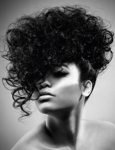 Curly hair. Dramatic evening look.