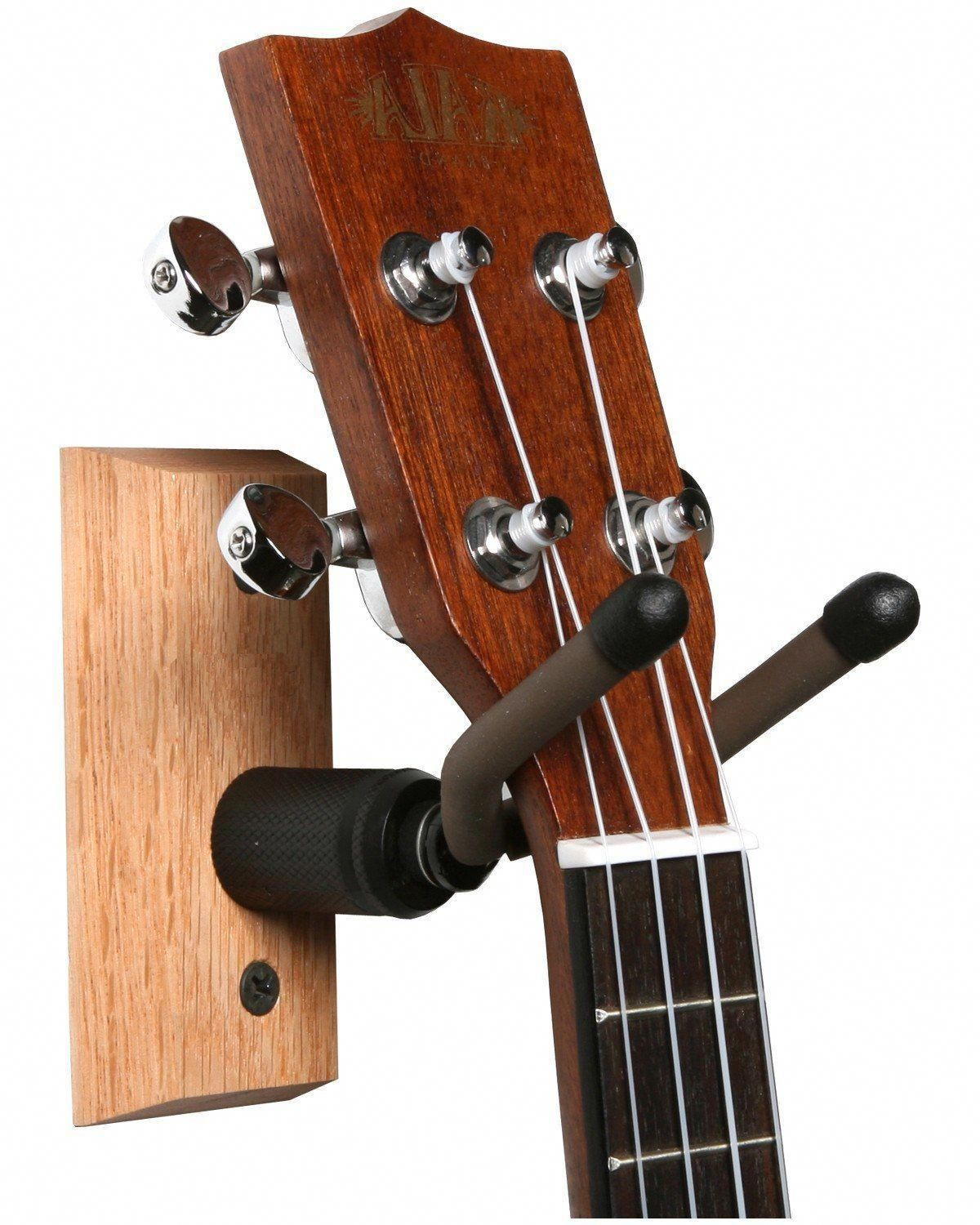 how to hold a ukulele standing up
