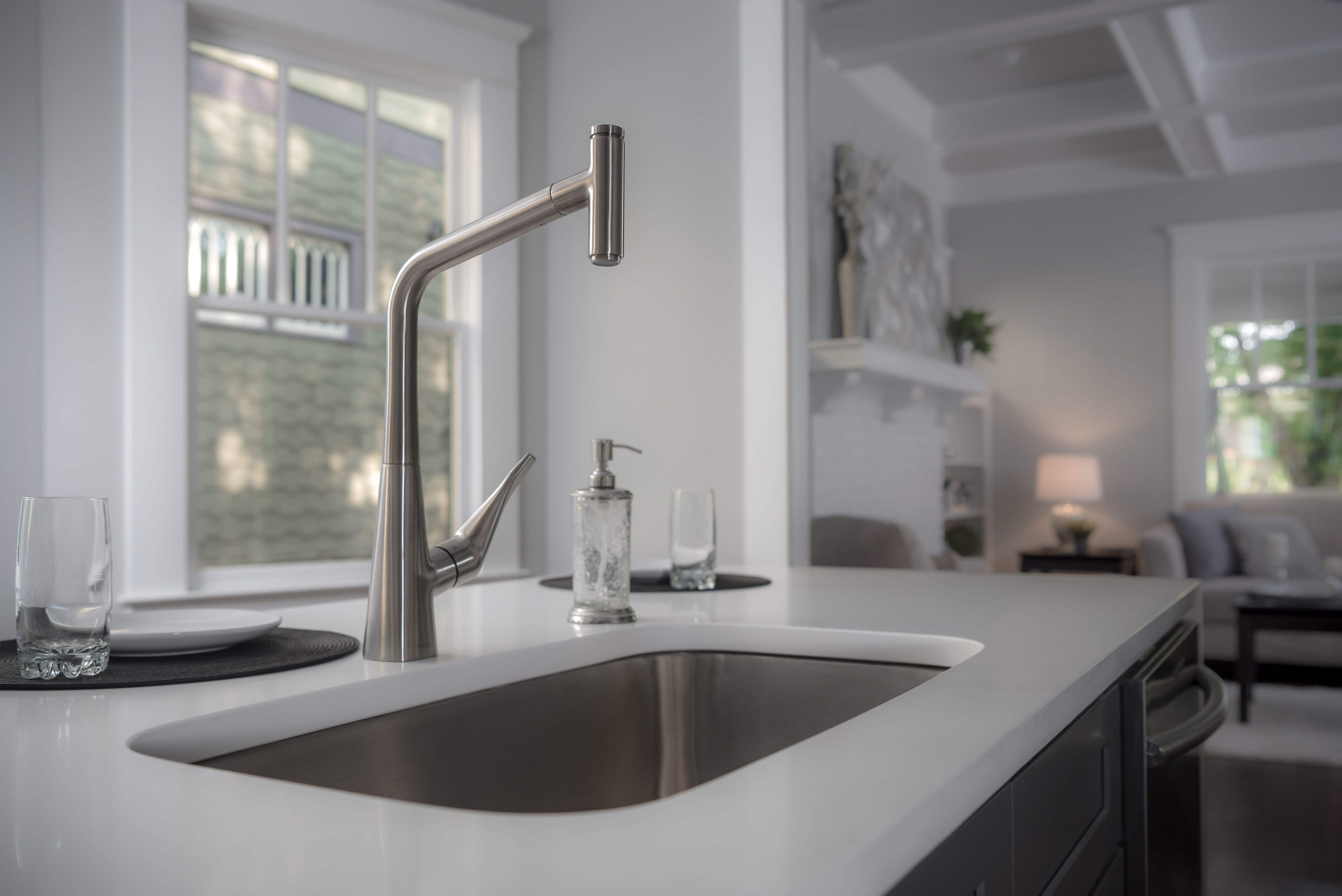 The Hansgrohe Metris Kitchen Faucet With White Cocuntertop