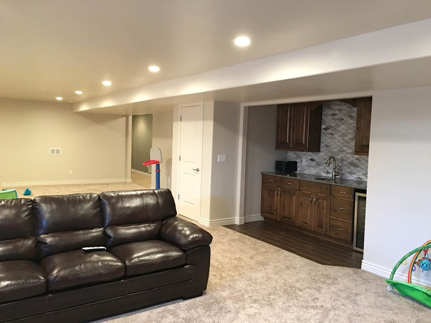 Hope Custom Building Finished This Partial Basement In Draper Utah To Include A Family Play Room Kitchenette Rusti Finishing Basement Rustic Fireplaces Home