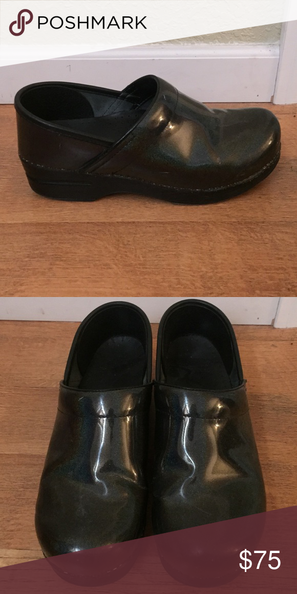Dansko clog Only worn for a few months. These shoes are so comfortable but not great for my line of work. Metallic black patent leather in color. Dansko Shoes Mules & Clogs