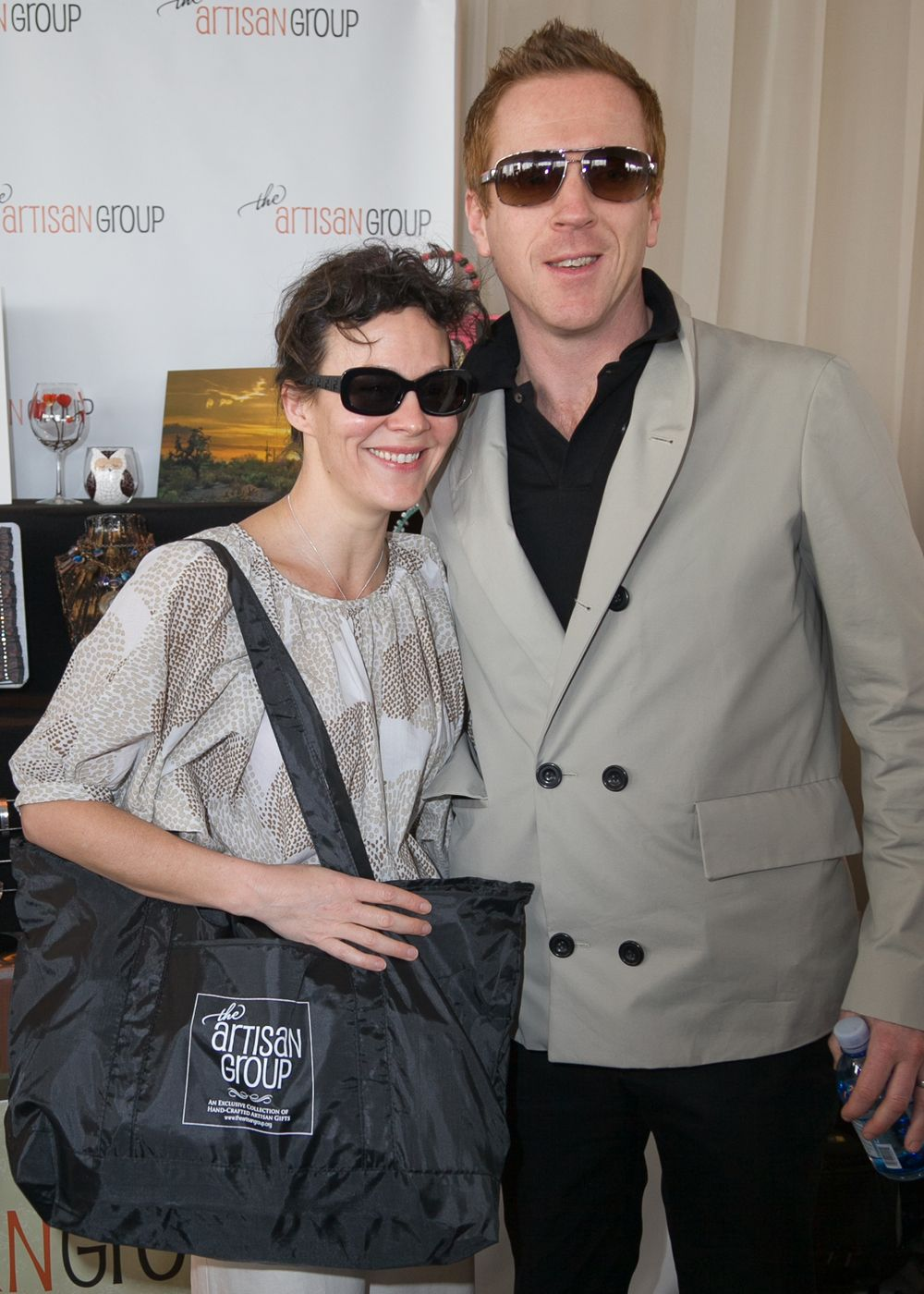 """Helen McRory of the """"Harry Potter"""" series and Golden Globe-nominee Damian Lewis with their Artisan Group swag bag."""